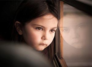 FAQ-CASA-girl-looking-out-window
