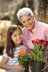 grandma and grandaughter with flowers